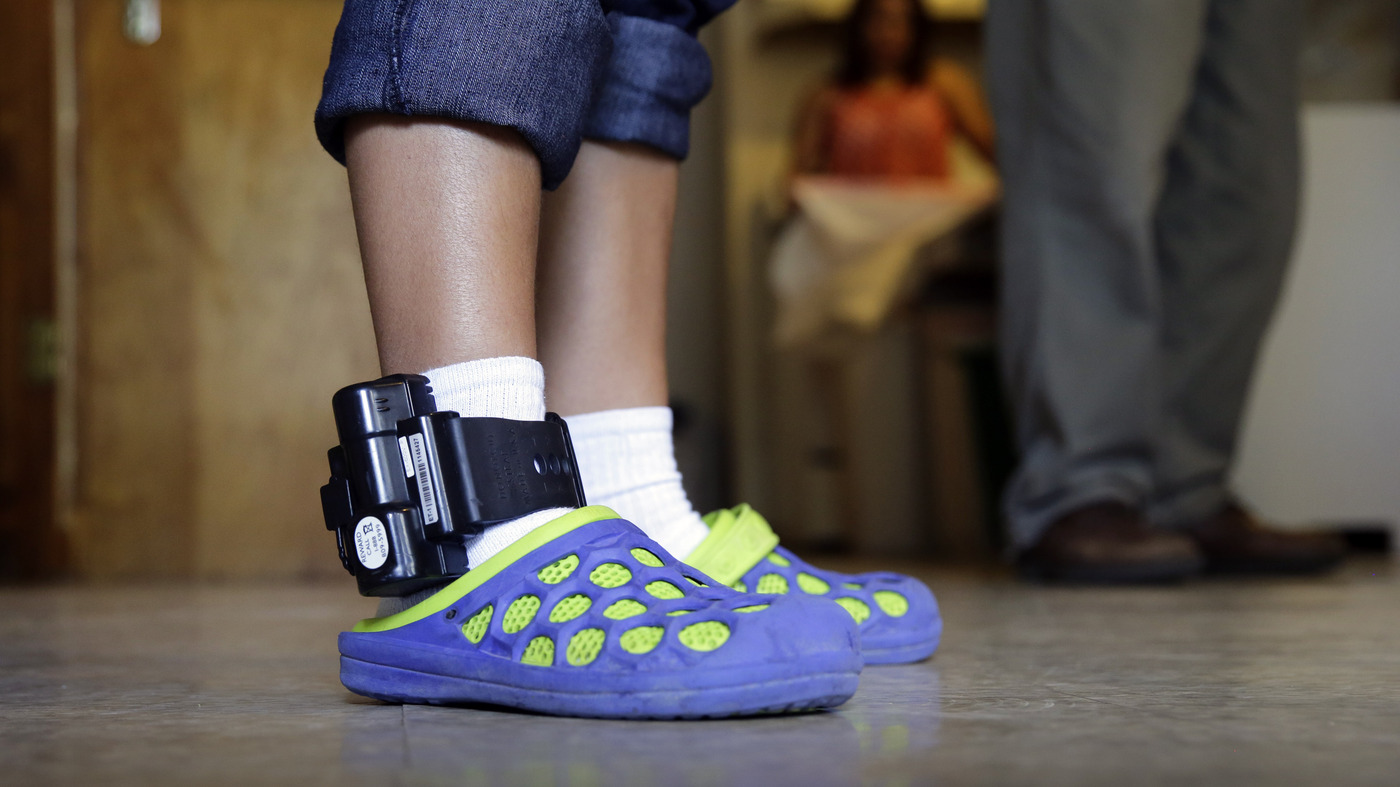 As Asylum Seekers Swap Prison Beds For Ankle Bracelets, Same Firm Profits