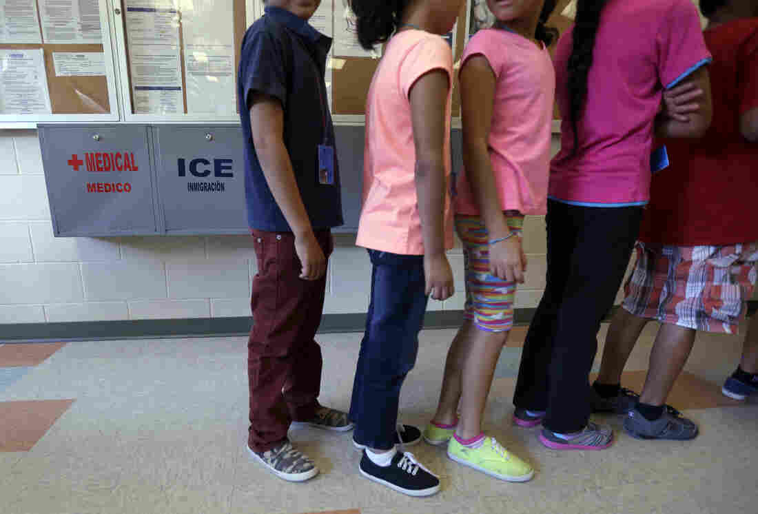 """Detained children line up in September 2014 in the cafeteria at the Karnes County Residential Center, a temporary home for migrant women and children detained at the border, in Karnes City, Texas. Homeland Security Secretary Jeh Johnson said earlier this year that federal officials were  making """"substantial changes"""" to end the long-term detention of migrant families who are being held in Texas."""