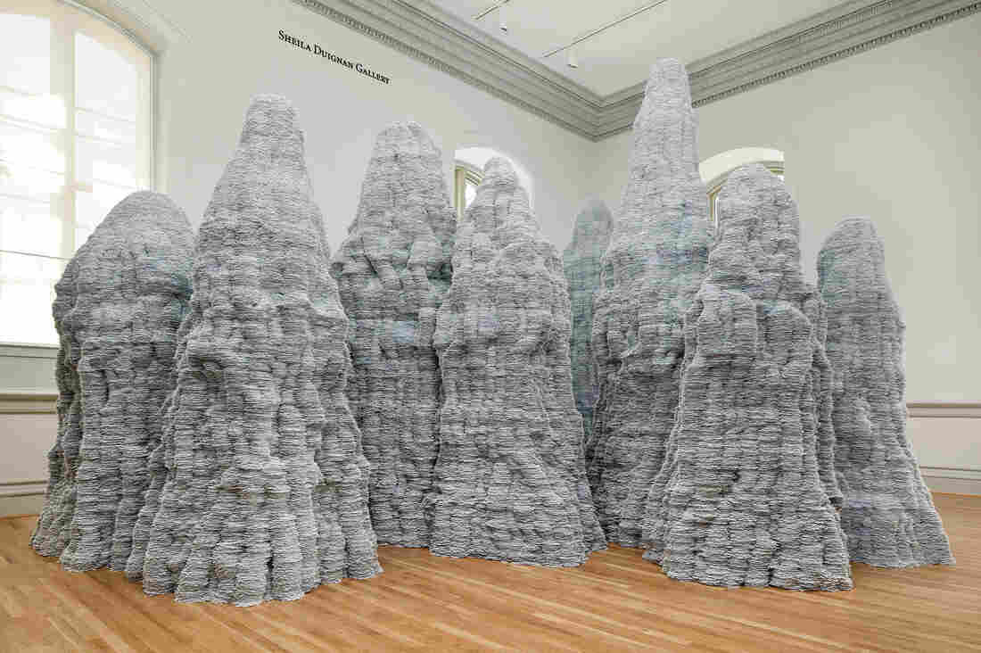 """You may have thought you used mountains of index cards while working on school research papers, but Tara Donovan shows you what mountains of index cards actually look like in her installation for the """"Wonder"""" exhibit."""