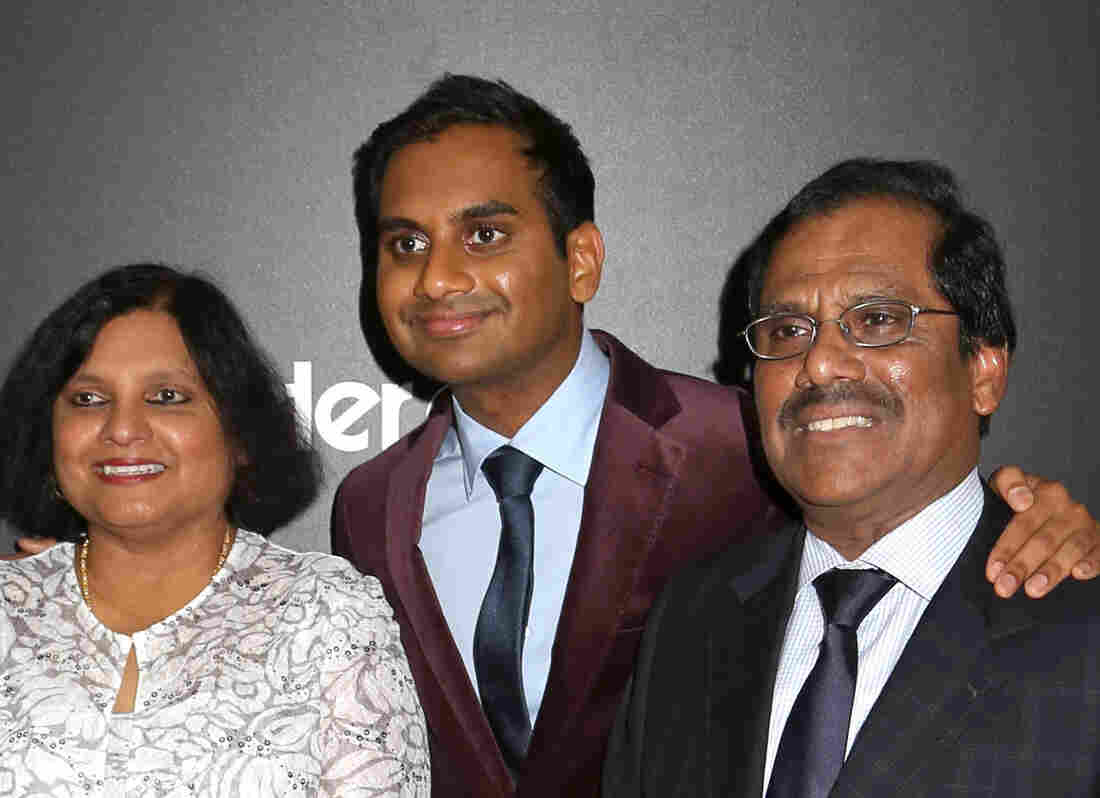 """Aziz Ansari is flanked by his parents, Fatima and Shoukath. """"Working with my parents [on his new TV series] has increased the quality of my relationship to my parents IN MY REAL LIFE,"""" he wrote."""
