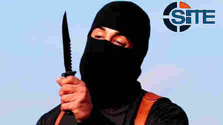 "A U.S. drone aircraft used a Hellfire missile to hit a target that was believed to include Mohammed Emwazi, known as ""Jihadi John,"" seen here in an image made from a militant video that has been verified by SITE Intel Group."