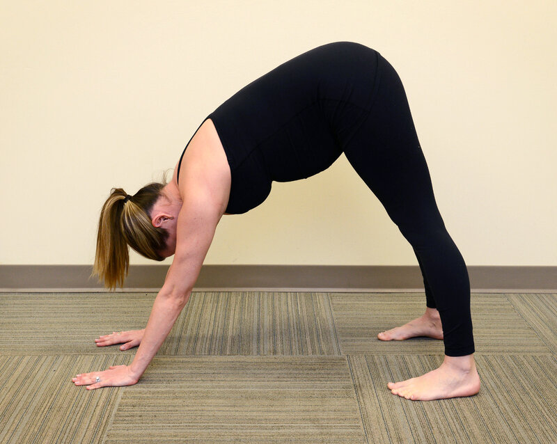 Downward facing dog pose (Chris Gahler/Jersey Shore University Medical Center/American College of Obstetricians and Gynecologists)
