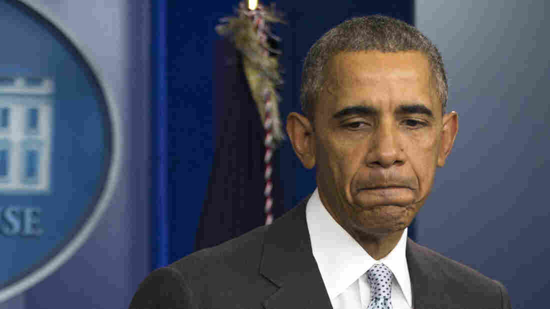 President Obama pauses as he speaks about attacks in Paris from the briefing room of the White House on Friday.