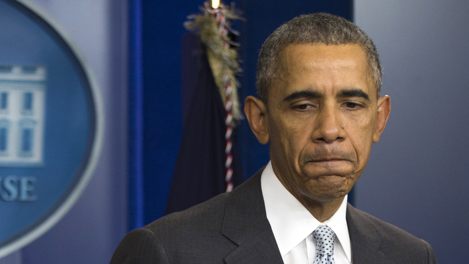 President Obama pauses as he speaks about attacks in Paris from the briefing room of the White House on Friday. (Evan Vucci/AP)