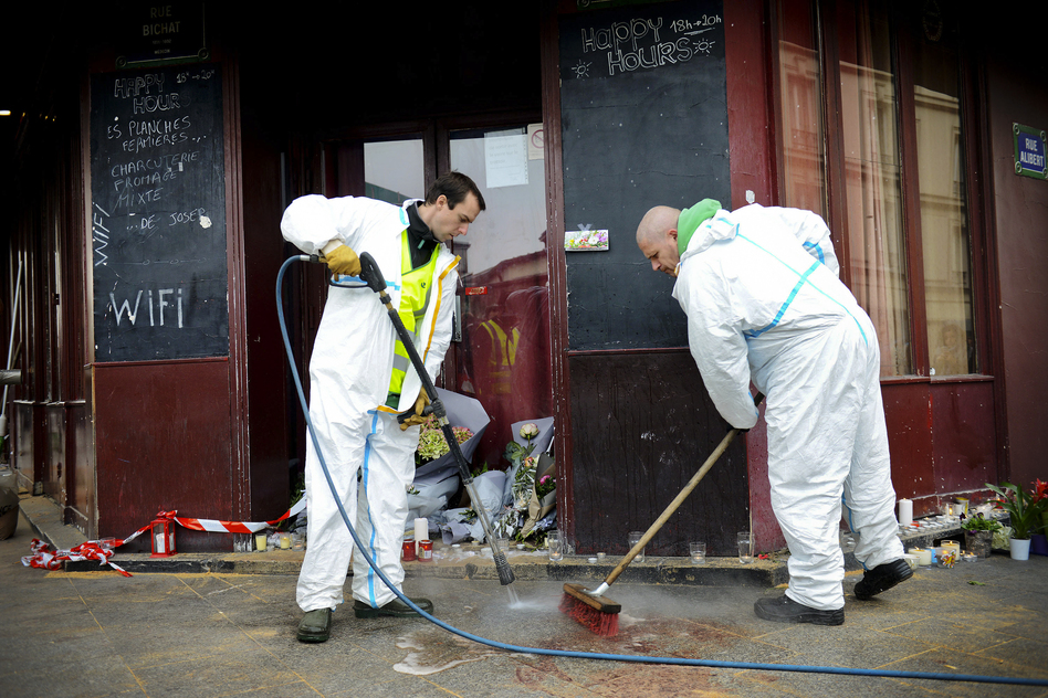 Municipal employees clean the exterior the Carillon cafe, one day after a terrorist attack hit Paris. ISIS has claimed responsibility for the deadly violence. (Antoine Antoniol/Getty Images)