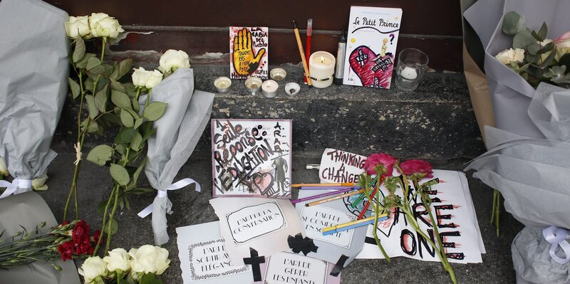 Impromptu memorials for the victims of Friday's terrorist attacks have been started all over Paris. Some mourners express both sorrow for the dead and concern over a potential backlash against French Muslims. (Olivier Corsan/Maxppp /Landov)