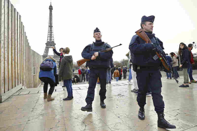 "Police patrol near the Eiffel Tower. French President Francois Hollande accused the Islamic State of staging the coordinated attacks, calling them an ""act of war."""