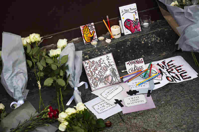 Cards, candles and flowers are placed in front of the Carillon cafe.