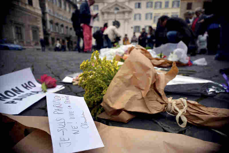In Italy, flowers are placed outside the French Embassy in Rome.