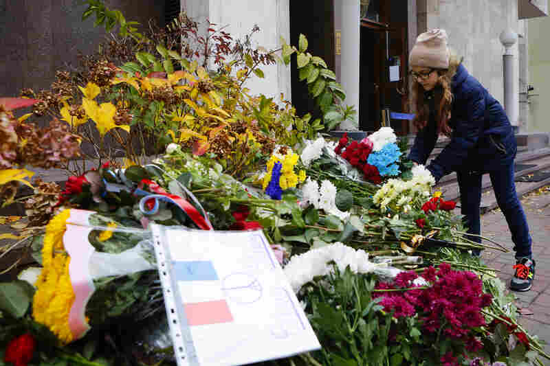 A girl lays flowers in front of the French Embassy in Kiev, Ukraine.