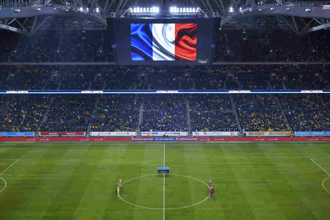 Sweden's and Denmark's national teams respect a minute of silence to honor the victims of Paris attacks ahead of the Euro 2016 play-off football match in Solna, Sweden.