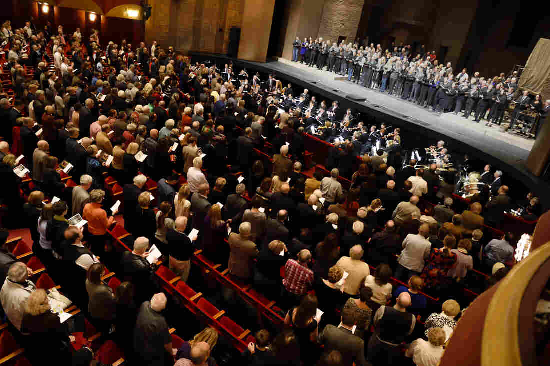 The Metropolitan Opera and Orchestra performs the French National Anthem during the matinee performance of Puccini's Tosca, in New York.