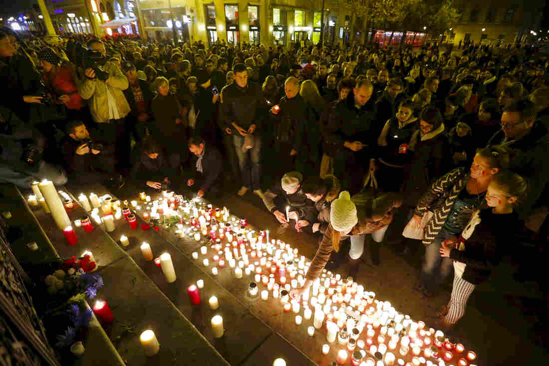 People light candles for the victims of the Paris attacks in the center of Budapest, Hungary.