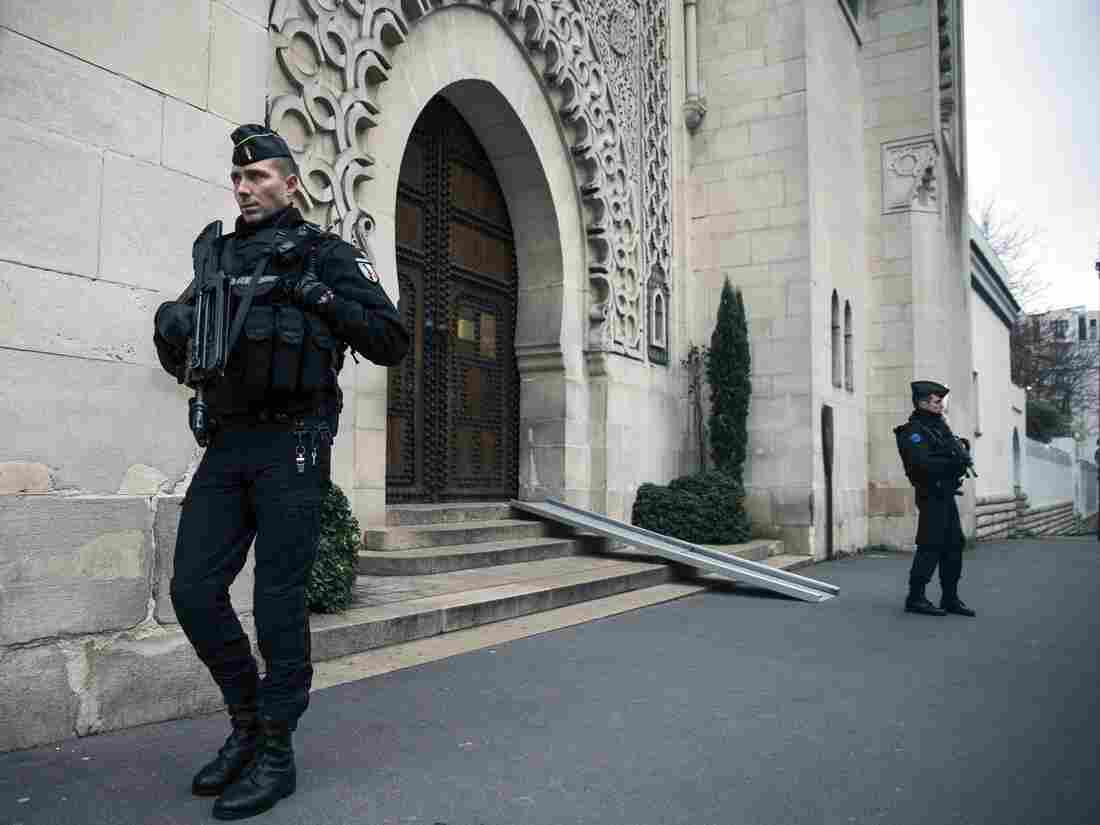 French law enforcement officers guard the entrance of the Great Mosque of Paris on Saturday.