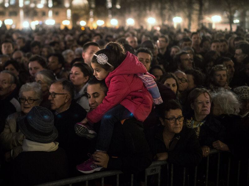 People gather outside of Notre Dame Cathedral in Paris, ahead of a ceremony for the victims of Friday's terrorist attacks. (David Ramos/Getty Images)