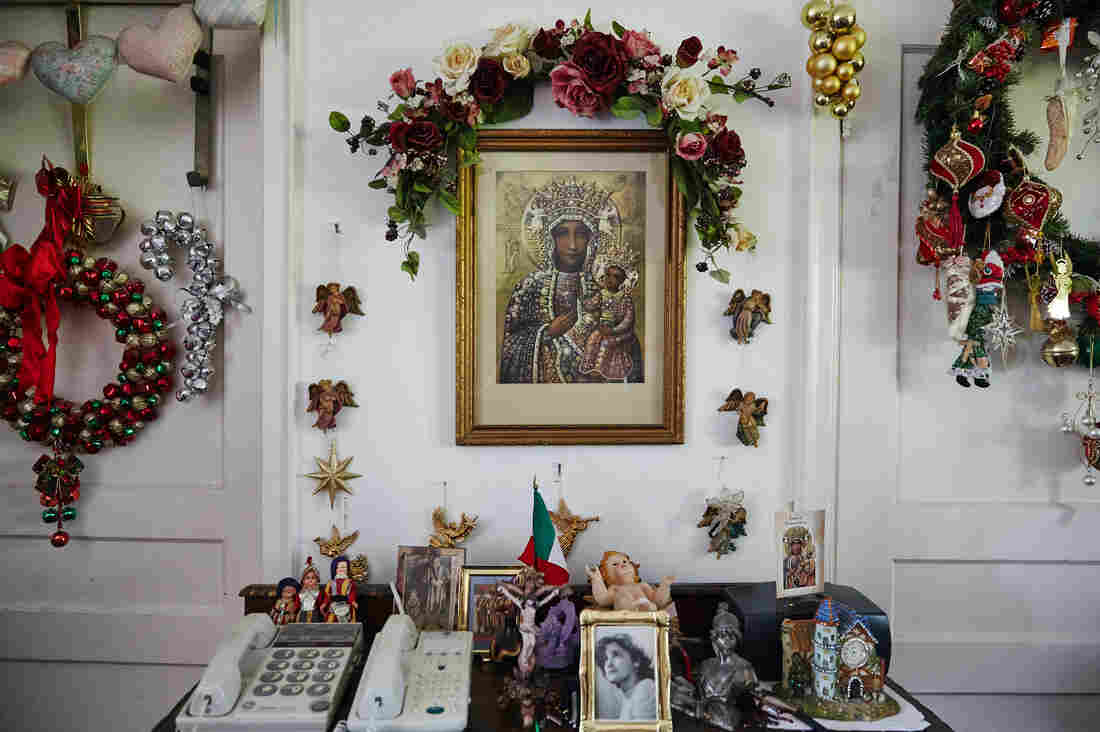 Religious icons and decorations are displayed in Smith's living room. She does not leave her home often because of her arthritis.