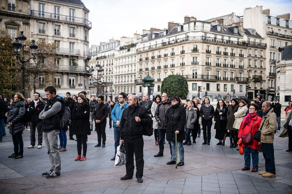 People gather to hold a minute of silence in front of the Paris city Hall, France, on Monday. (Christophe Petit Tesson /EPA /LANDOV)