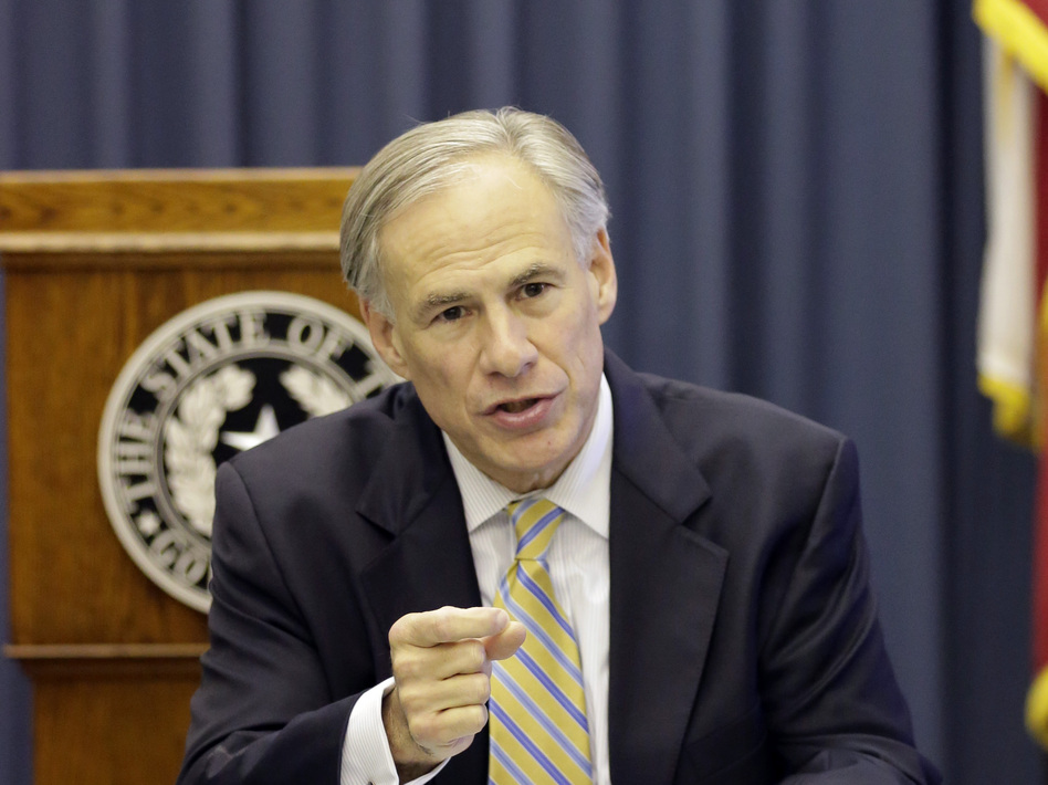 Texas Gov. Greg Abbott is one of a growing number of state leaders who oppose efforts to resettle Syrian refugees inside their states. He is shown here during a meeting with reporters in June. (Eric Gay/AP)
