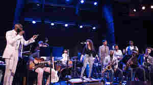 Michael Mwenso (left) leads tap dancer Michela Marino Lerman and a cast of Dizzy's Club Coca-Cola regulars in concert.