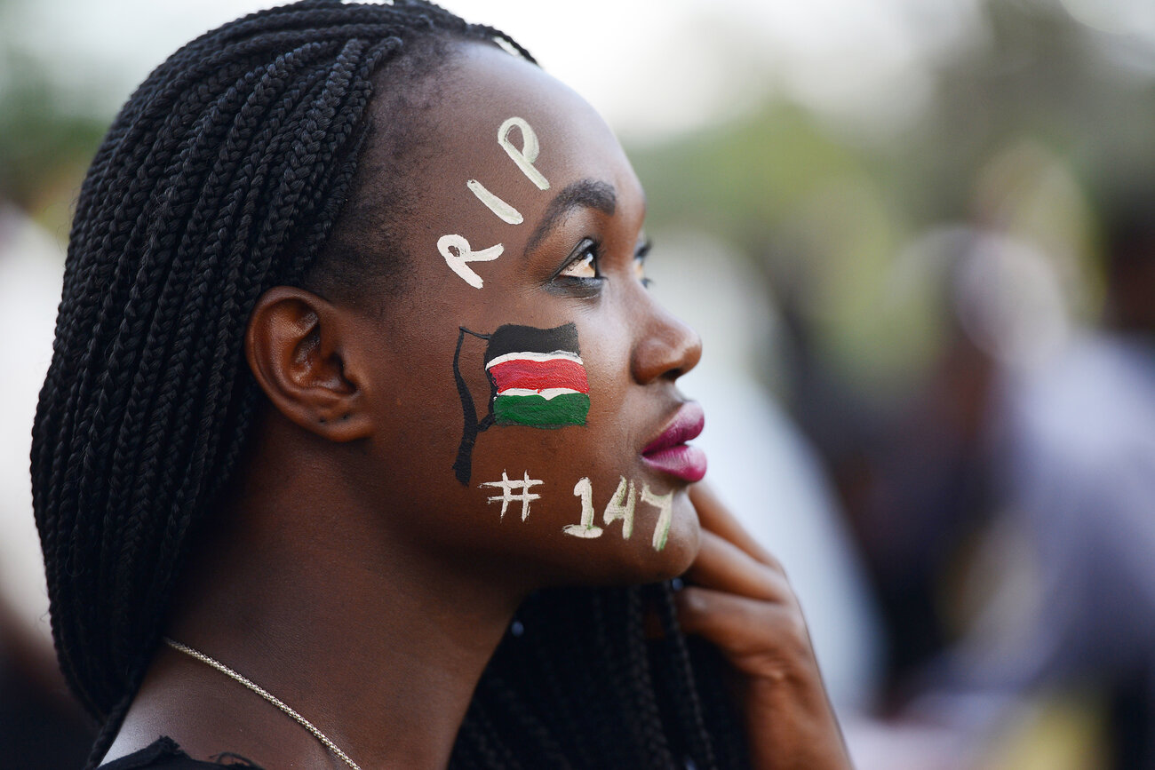 A woman in Nairobi attends a concert in honor of the victims of the terrorist attack that took 147 lives at Garissa University College in April.