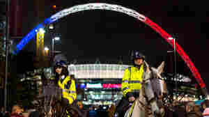 The famous arch at London's Wembley Stadium was illuminated in the colors of the French flag before the soccer game between England and France.