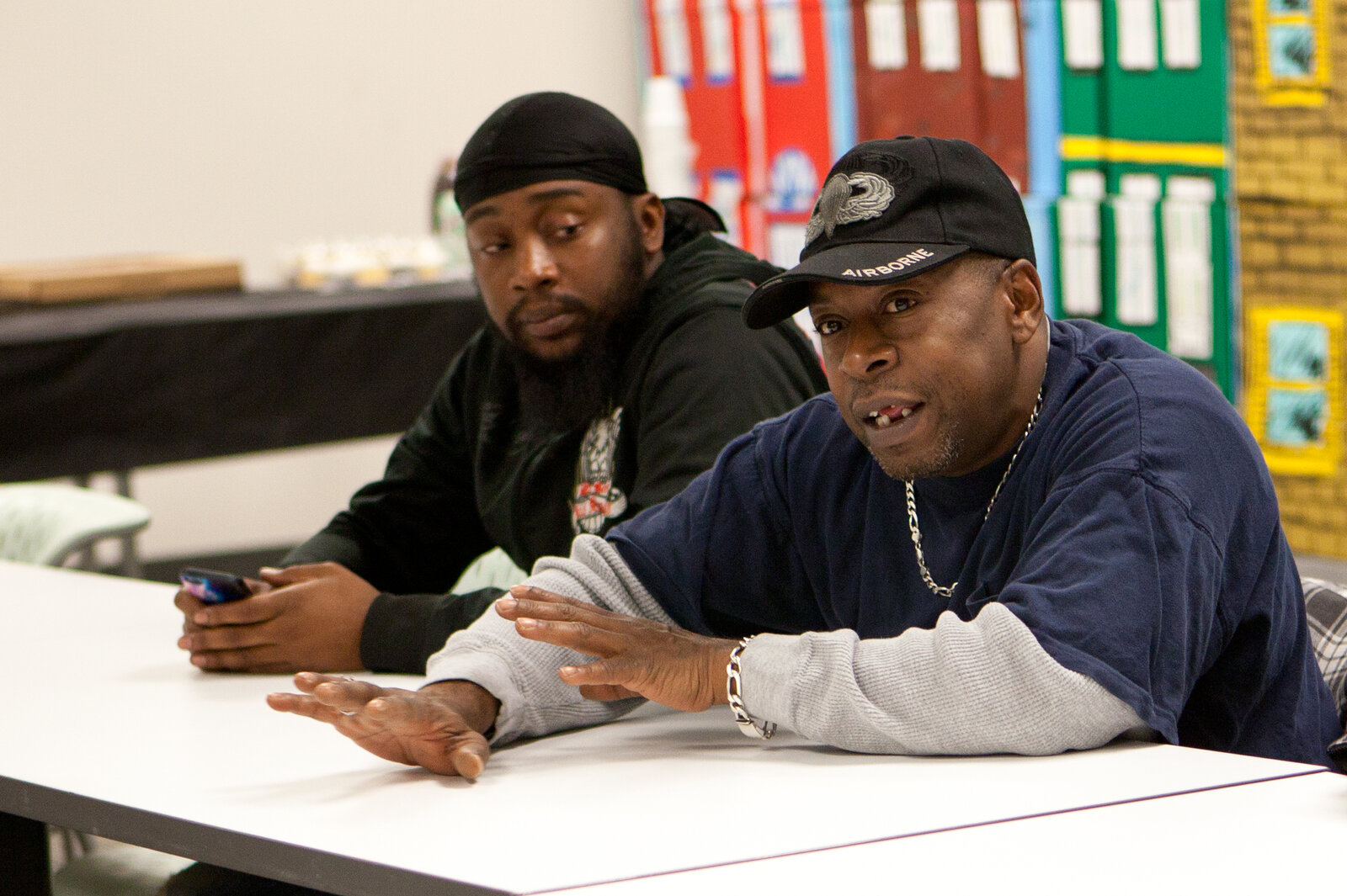 Harrelle Felipa (right) speaks during the Responsible Fathers meeting at the Center for Urban Families in Baltimore. His child support debt has accrued to $20,000 after he quit a job to be a stay-at-home dad.