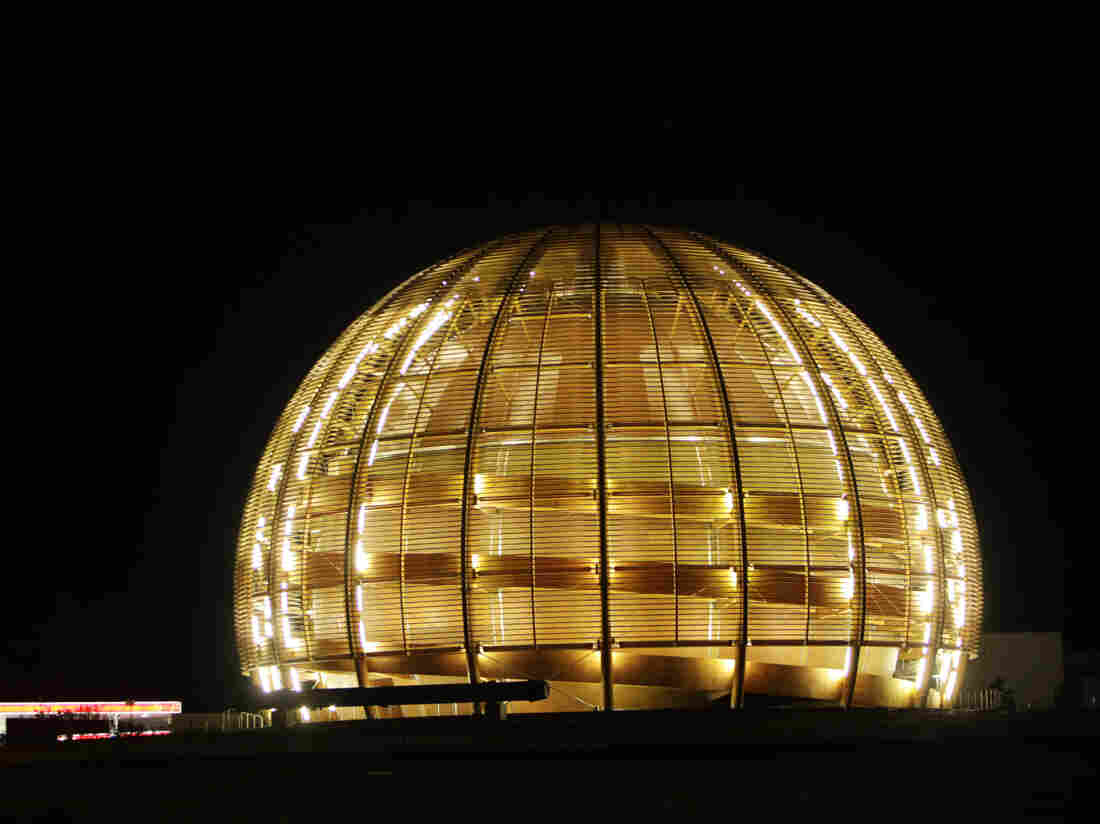 The globe of the European Organization for Nuclear Research, CERN, outside Geneva, Switzerland, is illuminated in this 2010 photo.