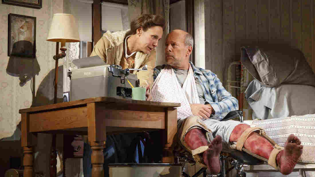 Laurie Metcalf portrays Annie Wilkes, left, and Bruce Willis portrays Paul Sheldon in Misery, currently playing at the Broadhurst Theatre in New York.