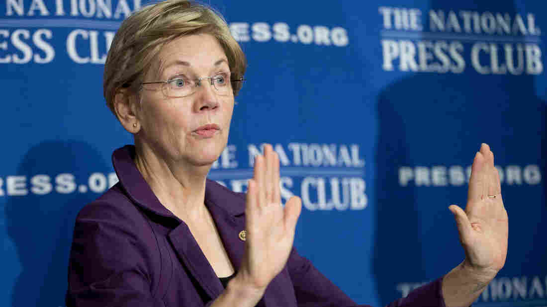 Sen. Elizabeth Warren, D-Mass., at the National Press Club Wednesday. Warren was critical of President Obama's plan to change how U.S. multinational companies are taxed.