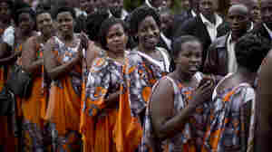 Rwandan women attend a memorial service for genocide victims in April. After years of political turmoil, women in the country are narrowing the economic and political gap with men.