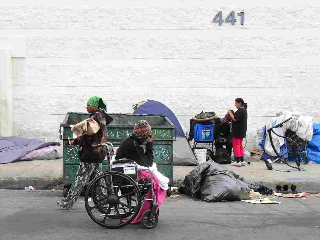 Homeless women prepare for a night spent on a street near Skid Row in Los Angeles, in May. Not every case of homelessness is so easy to spot as this, though; some groups say the Department of Housing and Urban Development numbers missed many people without stable housing.