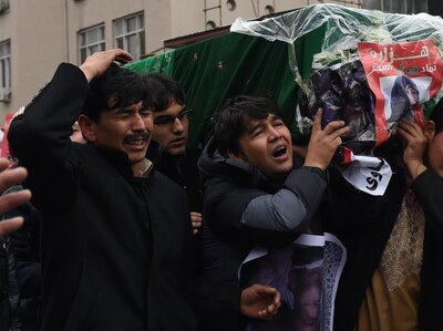 In a Kabul demonstration last week, Afghan protesters carry a coffin with the decapitated body of one of seven Shiite Muslim Hazaras abducted and killed in southern Afghanistan. Officials blamed Afghan militants loyal to ISIS for the killings. Thousands of protesters marched in Kabul to demand justice for the victims, who included a 9-year-old girl.
