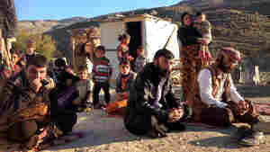 After their villages were overrun by ISIS last year, hundreds of Yazidis sought safety on Mount Sinjar, a place they consider miraculous. Many families, including this one, refuse to leave the mountain.