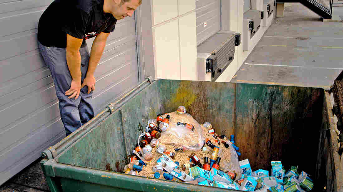 A scene from Just Eat It: A Food Waste Story. Filmmaker Grant Baldwin checks out a dumpster of excess, but edible, food.