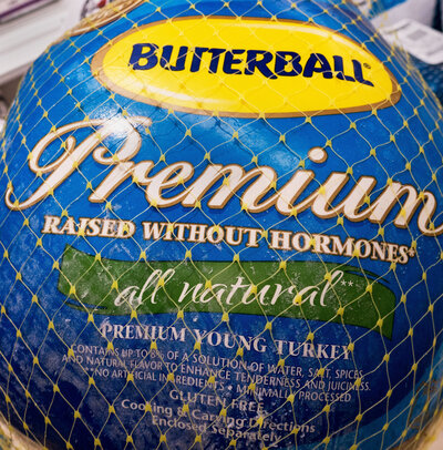 "A Butterball turkey for sale in November 2014, in Centreville, Va. Terms like ""premium"" and ""raised without hormones"" tell you little about the quality of the turkey or how it was raised. (Paul J. Richards/AFP/Getty)"