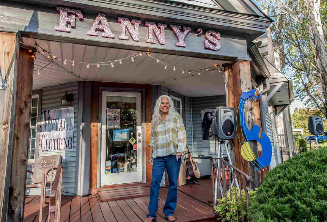 June Millington, the author of the memoir Land of a Thousand Bridges: Island Girl in a Rock & Roll World, on the porch of the Fanny's House of Music in East Nashville. The shop is named after Millington's band, Fanny.