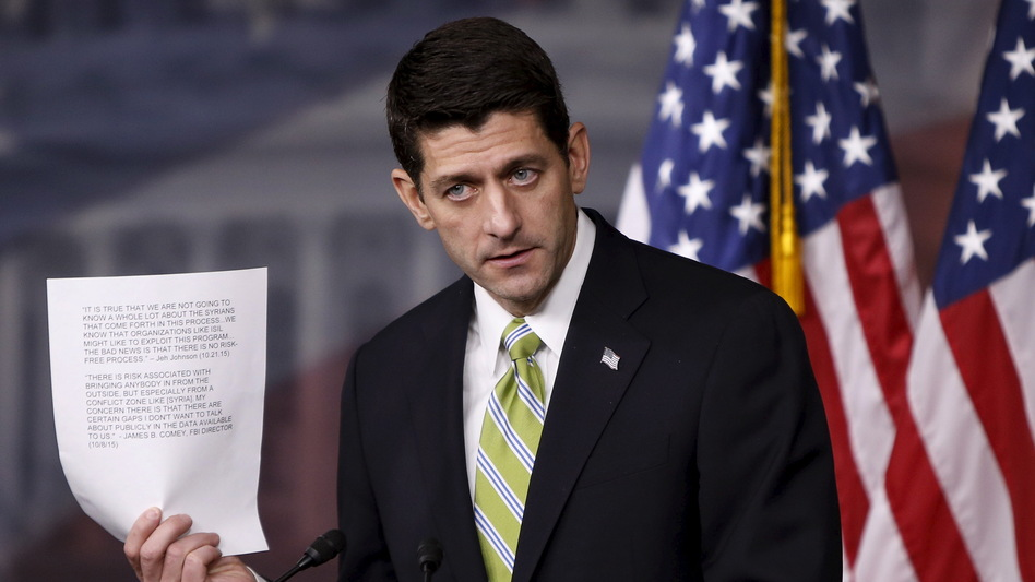 Speaker of the House Paul Ryan holds up statements from the FBI director and the secretary of Homeland Security about the risk involved in admitting refugees from Syria, during a news conference Wednesday about the House bill calling for a stricter vetting process for refugees from Syria and Iraq. (Gary Cameron/Reuters/Landov)