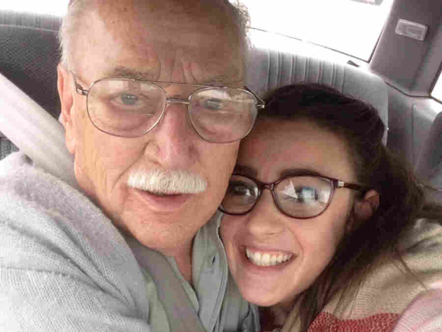 Kara Masteller sits with her grandfather, James Kennicott, in a car in the parking lot of an Applebee's in Waterloo, Iowa.