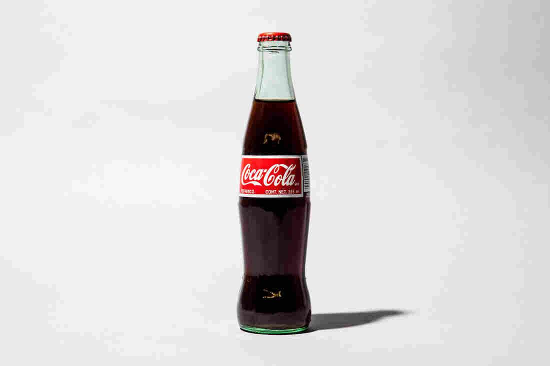from grocery shelves to pop culture a century of coca cola bottles npr. Black Bedroom Furniture Sets. Home Design Ideas