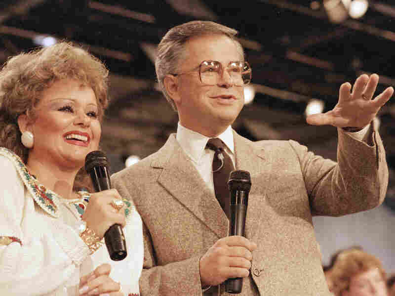 Jim Bakker and his first wife, Tammy Faye, in 1986. Bakker now sells an array of food products on the television show he co-hosts with his second wife, Lori Bakker.