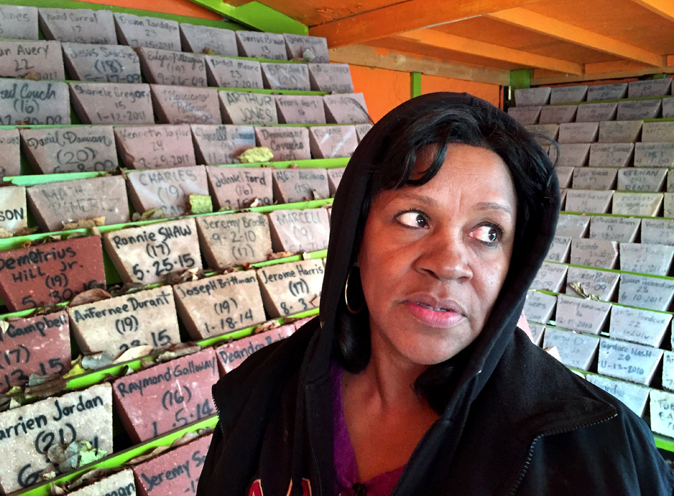 Anti-violence activist Diane Latiker stands before the memorial for young people lost to violence in Chicago over the last several years. More than 500 stones honor the victims and there are hundreds more that still need to be added. (Peter Breslow/NPR)