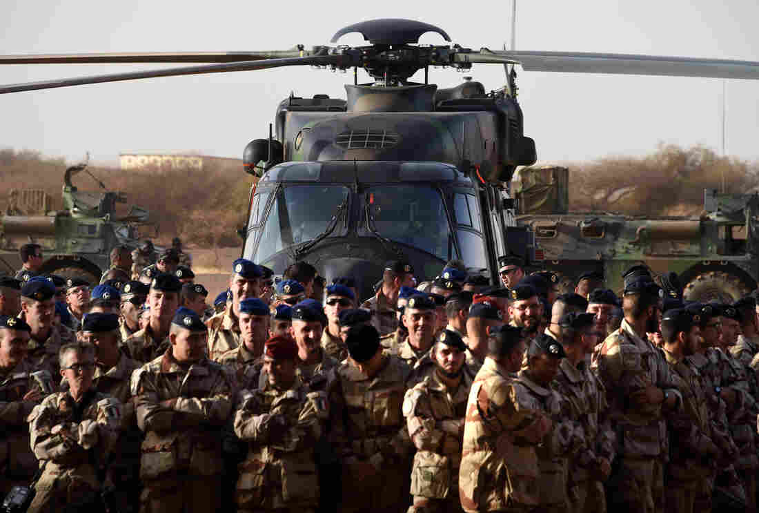 French soldiers listen to the country's defense minister in January of this year at a French base outside the northern Mali city of Gao. The French military routed a radical Islamist group from large parts of northern Mali in 2013 and have remained to assist the government. French troops are currently in five former colonies in Africa backing the governments.