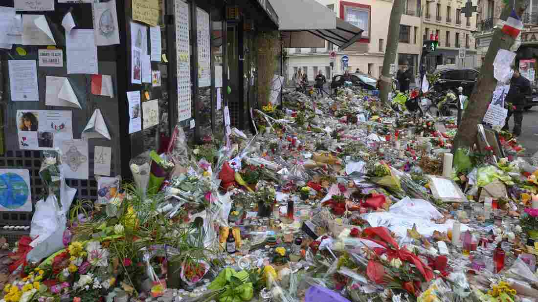 Copies of Ernest Hemingway's book A Moveable Feast are being left at spots in Paris where attackers set upon civilians last week. Here, the Cafe Belle Equipe is seen on rue de Charonne, where flowers and other mementos mark the site.