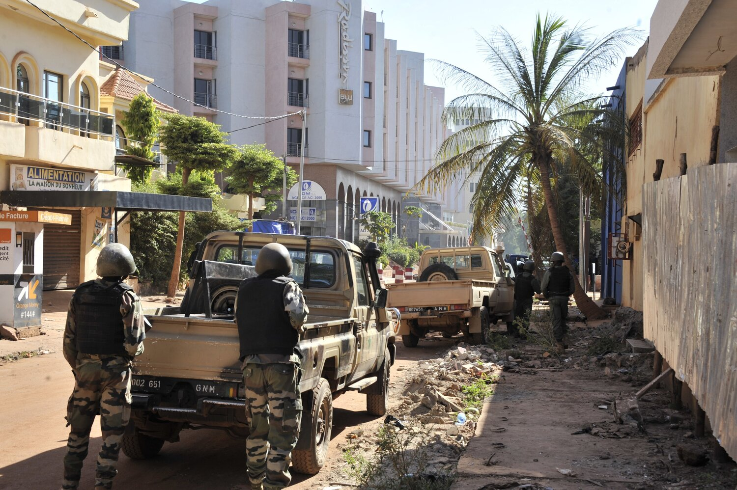 Malian troops take position outside the Radisson Blu hotel in Bamako on Friday. Gunmen went on a shooting rampage at the hotel in the capital of Bamako, seizing 170 guests and staff. (Habibou Kouyate/AFP/Getty Images)