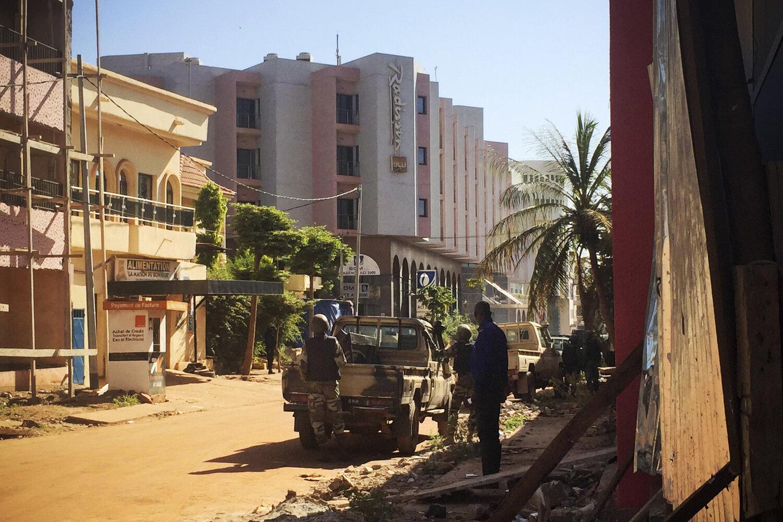 Malian troops take position outside the hotel in Bamako. (Sebastien Rieussec/AFP/Getty Images)
