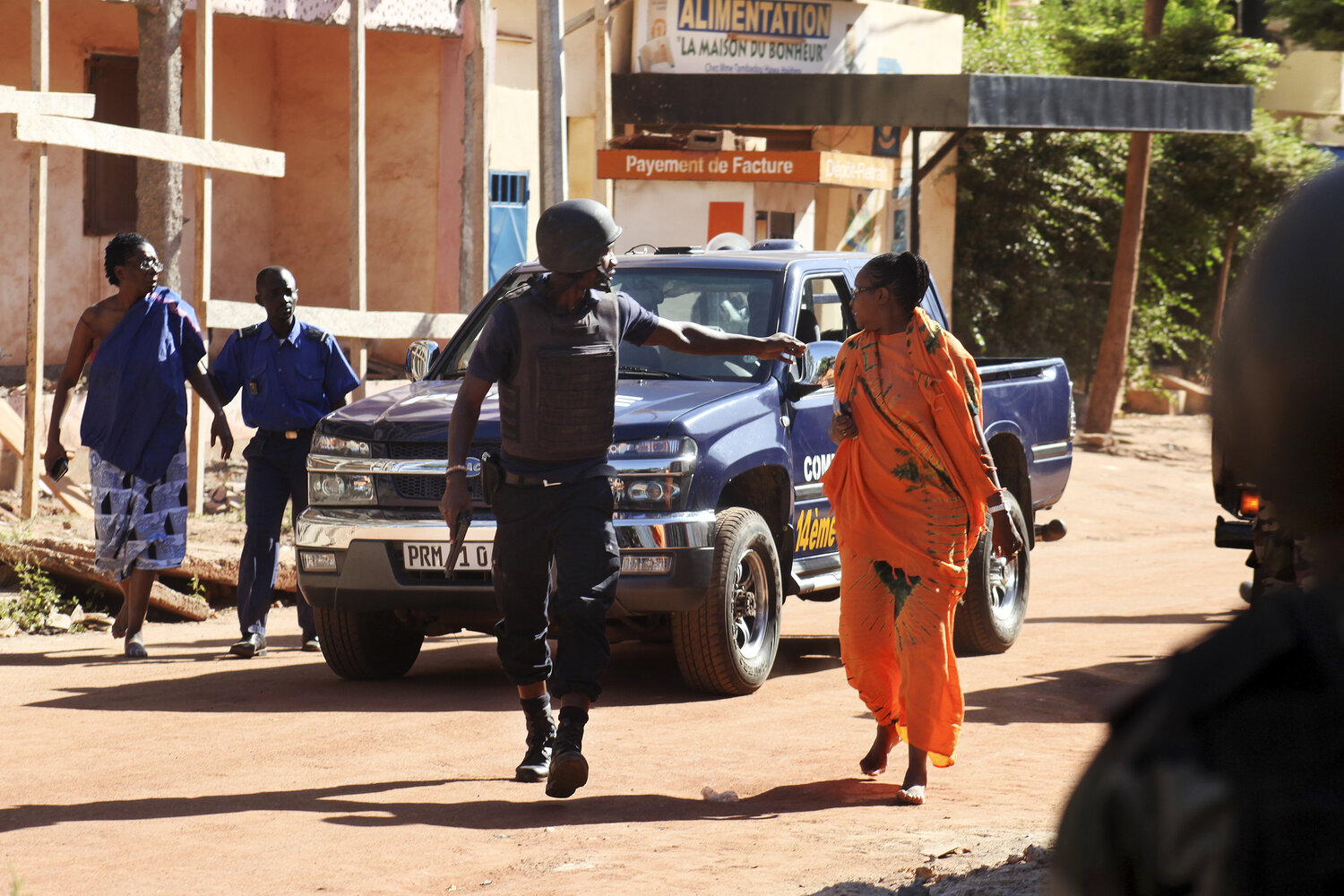 Security forces evacuate two women near the Radisson Blu. (Habibou Kouyate/AFP/Getty Images)