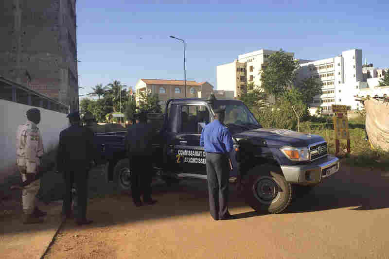 Malian security forces take position in Bamako. The reported number of hostages at risk has fluctuated, in part because some guests managed to escape from the hotel and others were released.
