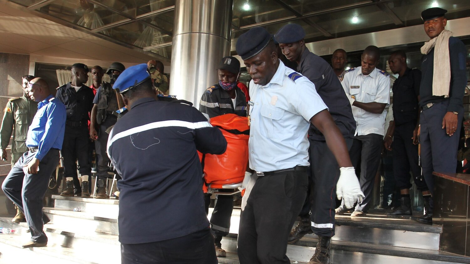 Officers in Mali evacuate bodies of victims from the Radisson Blu hotel in the capital of Bamako Friday, after gunmen seized the hotel and trapped people inside. (Habibou Kouyate/AFP/Getty Images)
