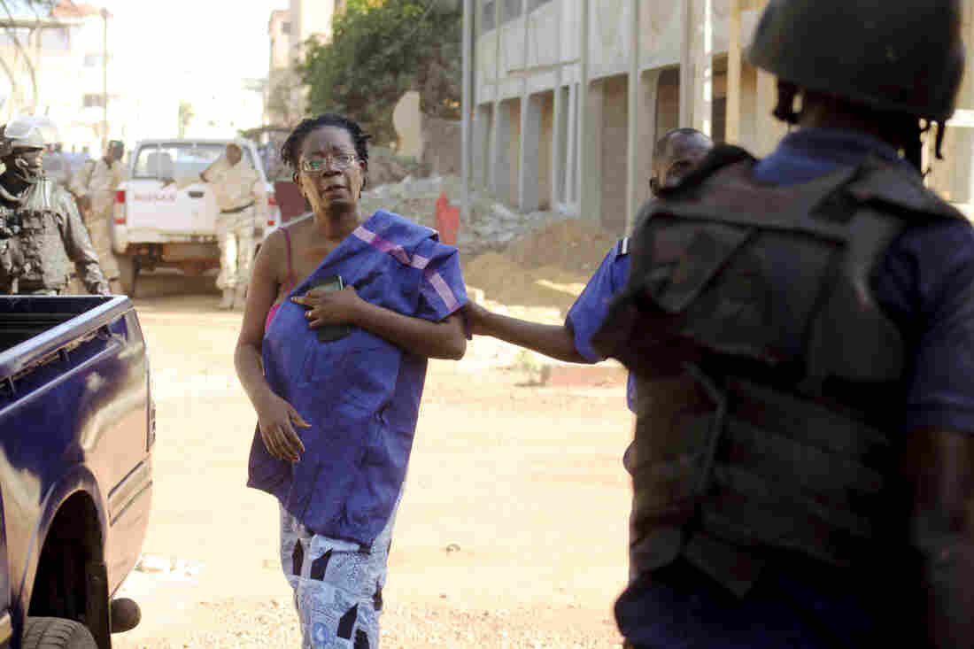 Malian security forces escort a hostage freed from the Radisson Blu hotel.