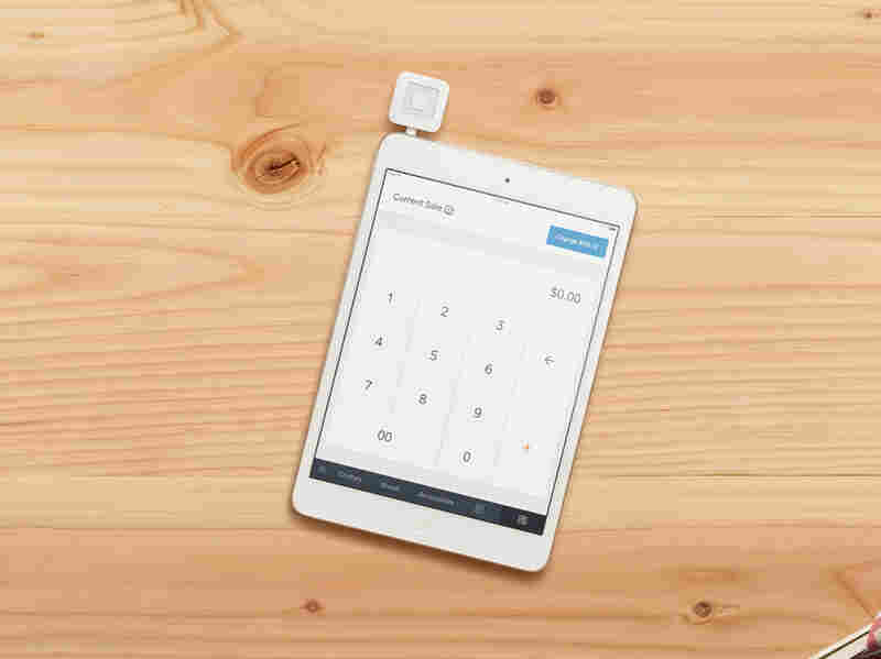 The mobile payment device by Square allows small merchants to swipe customers' payment cards with a phone.